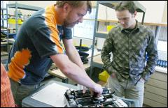 Senior Engineer Christian Herden and Manufacturing Coordinator Jeff Howell assembling an embosser
